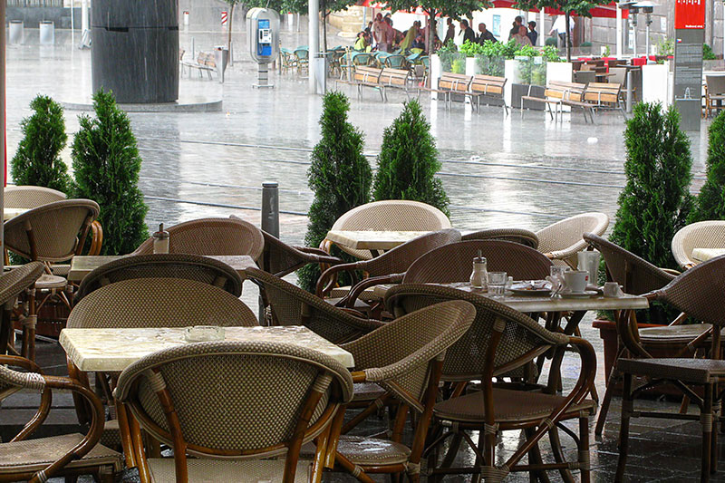 Rain outside a cafe in Paris